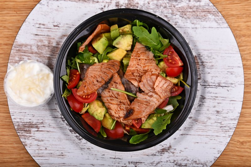 Hot teriyaki marinated salmon salad