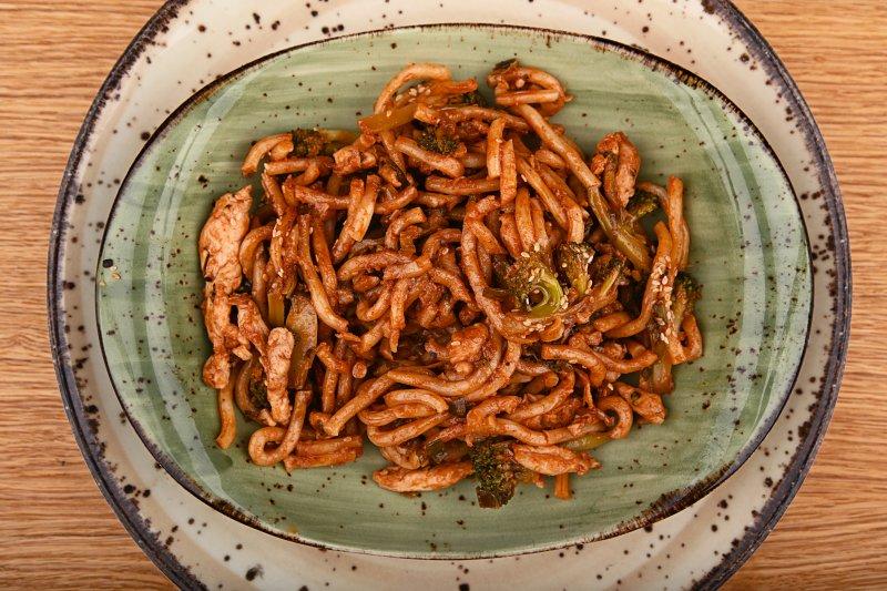 Stir fried hot udon noodles with pork