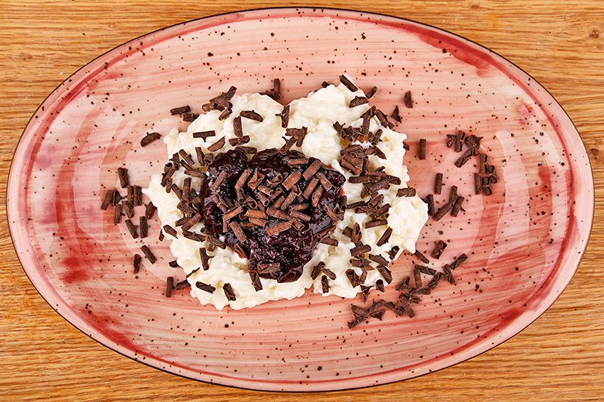 Rice pudding with coconut milk and cherry sauce