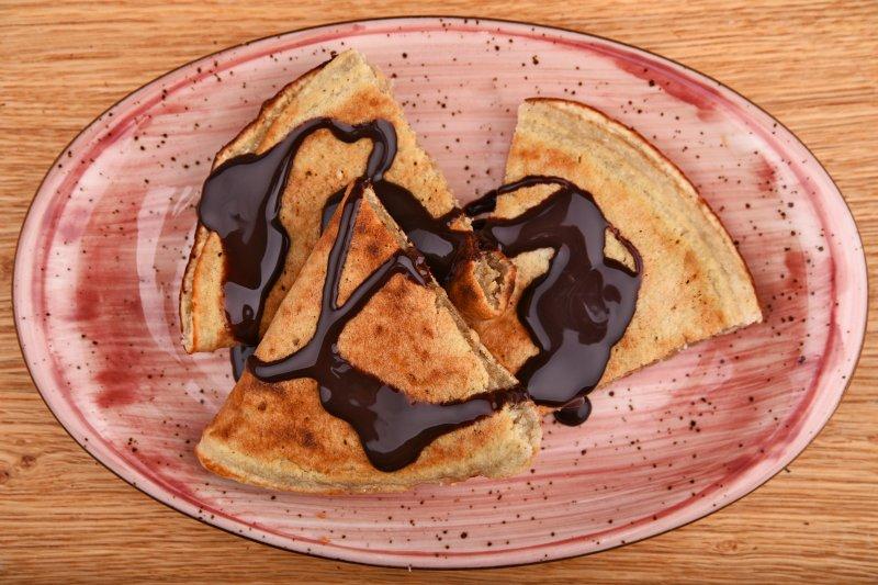 Coconut pancake with chocholate sauce