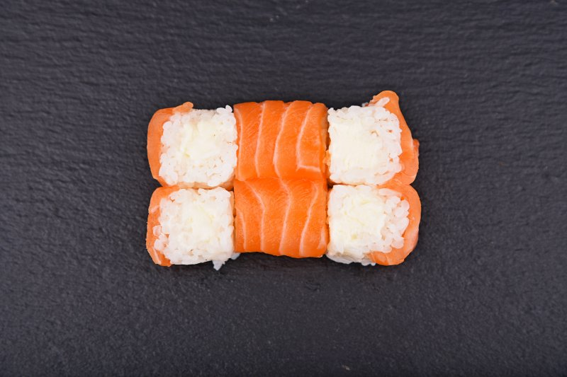 Cream cheese maki rolled up with salmon