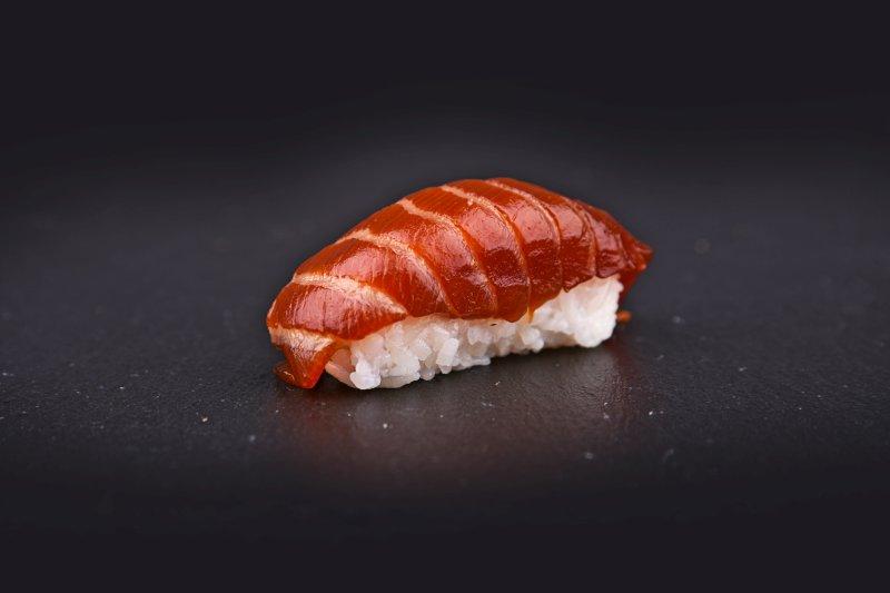 Salmon nigiri in hot teriyaki sauce