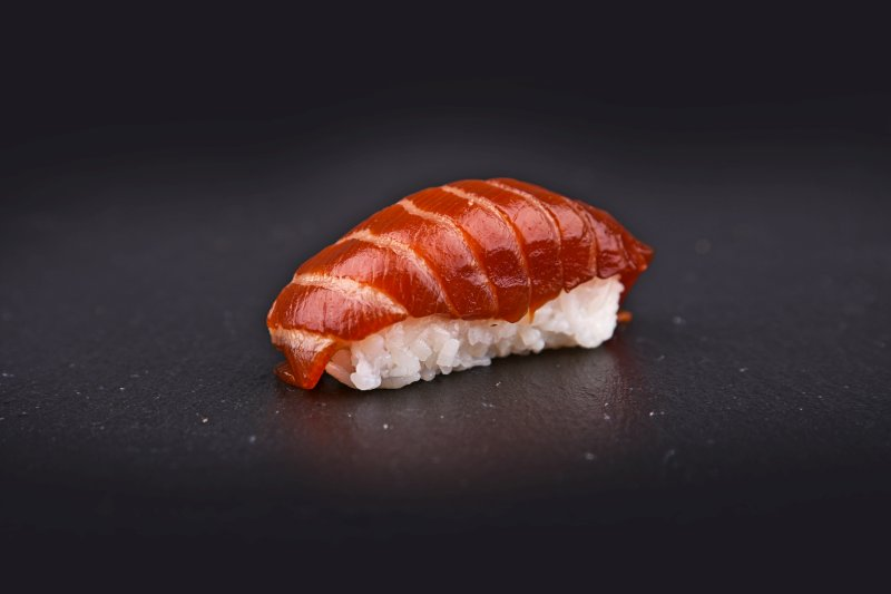 Salmon nigiri in hot teriyaki sauce