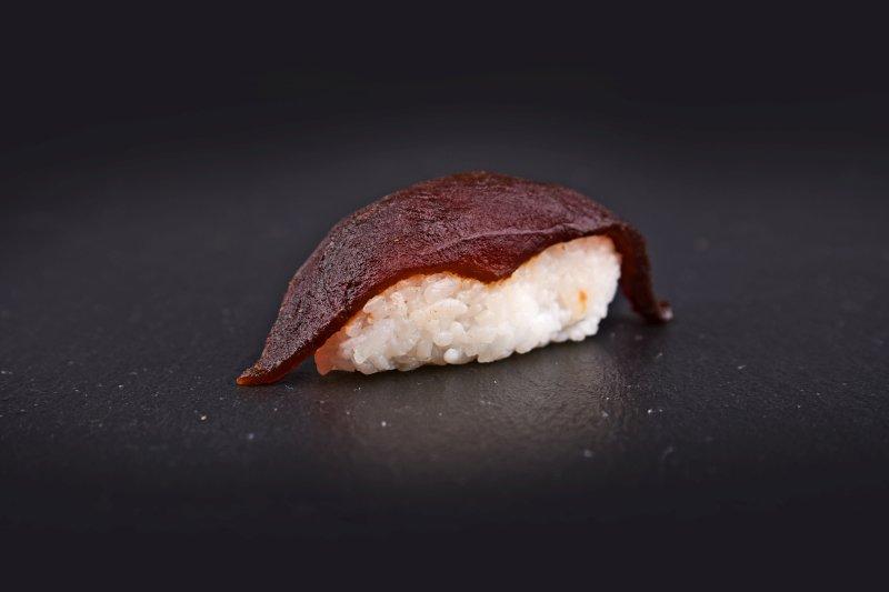 Tuna nigiri in hot teriyaki sauce