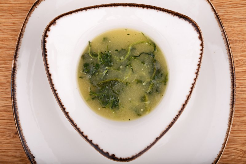 Miso soup with steamed spinach and garlic