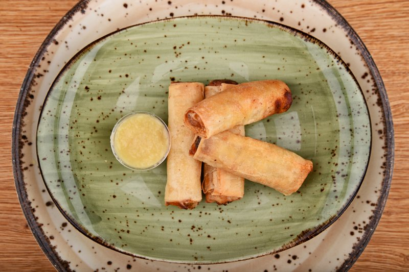 Spring rolls stuffed with vegetables and cheese, with ginger sauce