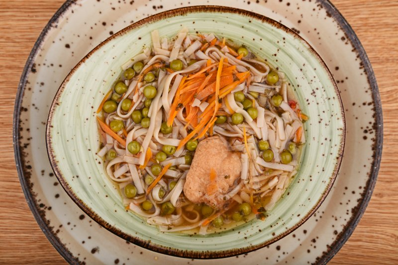 Japanese hot chicken soup with rice noodles and vegetables